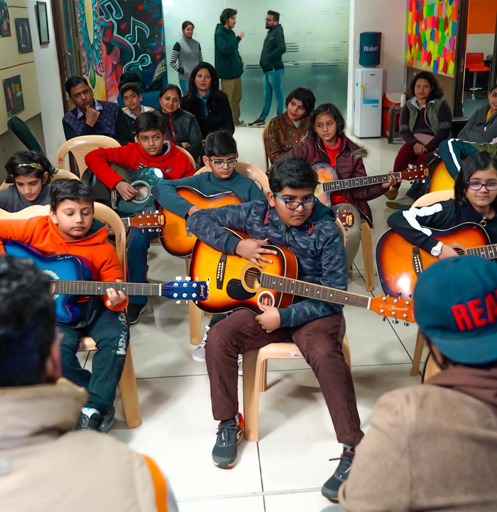 Children Take Guitar Classes In Gurgaon