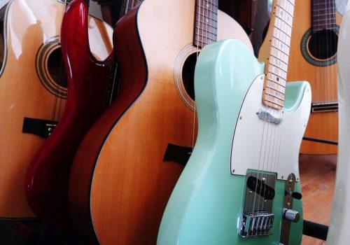 Guitars On A Guitar Rack Indoors